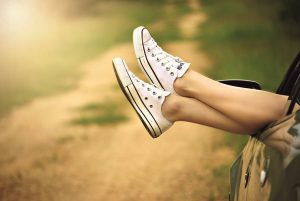 person showing its feet wearing white sneakers 300x201 كيف تجد راحة البال ؟