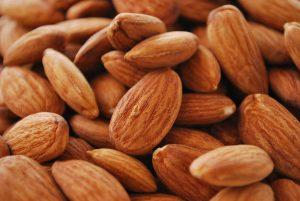 almond 300x201 ارفع معدل هرمون السيروتونين لتكون سعيداً