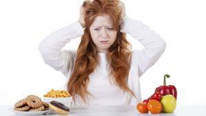 girl choosing from veg or donuts 8 reasons diets make you fat by healthista 300x169 الريجيم يكسبك الكثير من الدهون